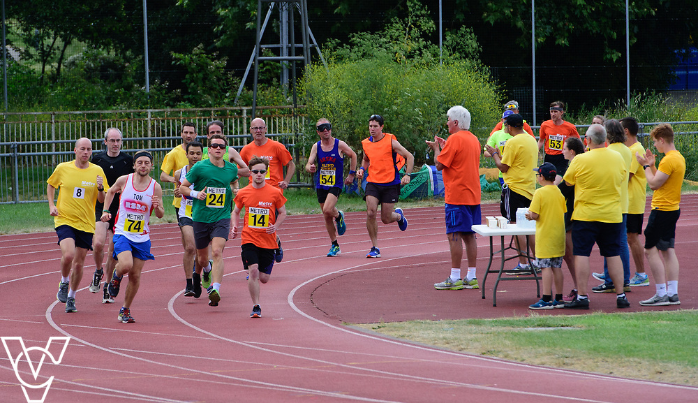 Event: 5000 meter relay<br /> Competitors, from left: Luke Boulding, Competitor #74, Rhys Jones and Tom Barton<br /> <br /> Metro Blind Sport's 42nd Athletics Open, held at Mile End Stadium, Tower Hamlets, London.<br /> <br /> Picture: Chris Vaughan Photography for Metro Blind Sports<br /> Date: June 16, 2018