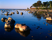 Boulders and limestone concretions in shallow water of Lake Huron at Kettle Point, Ontario, Canada.
