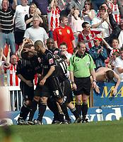 Photo: Kevin Poolman.<br />Swindon Town v Brentford. Coca Cola League 1. 22/04/2006. Brentford players celebrate their 2nd goal.