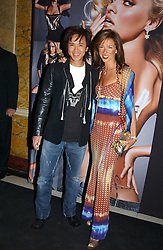 ANDY WONG and HEATHER KERZNER at a party to celebrate Pamela Anderson's new role as spokesperson and newest face of the MAC Aids Fund's Viva Glam V Campaign held at Home House, Portman Square, London on 21st April 2005.<br /><br />NON EXCLUSIVE - WORLD RIGHTS