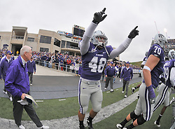 Nov 14, 2009; Manhattan, KS, USA; Kansas State head coach Bill Snyder (left) head onto the field with his team before the game agains the Missouri Tigers at Bill Snyder Family Stadium. Mandatory Credit: Denny Medley-US PRESSWIRE