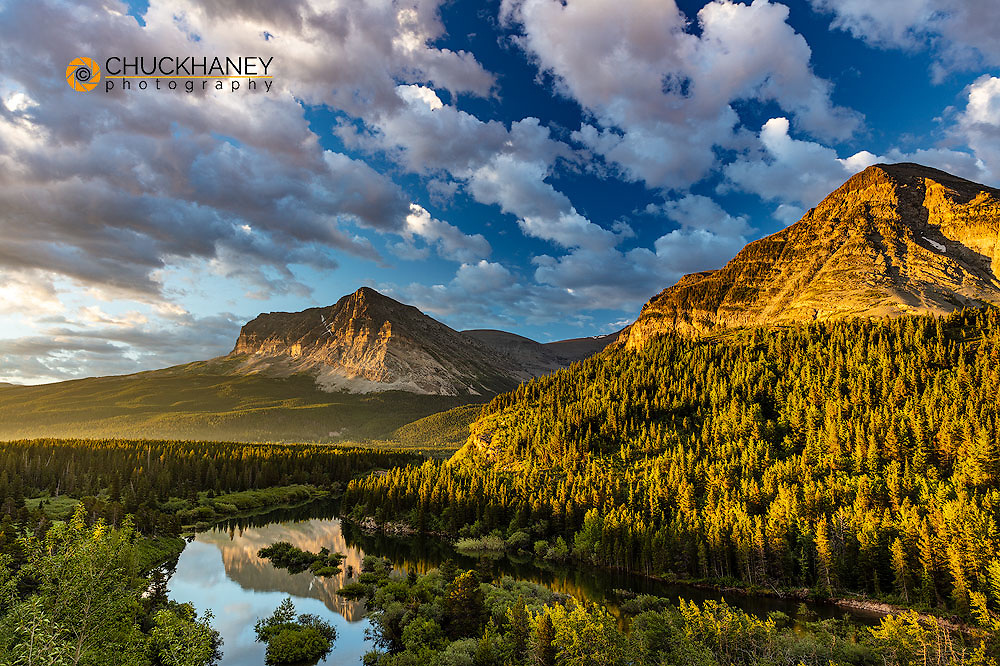 Wynn and Allen Mountains catch morning light above Swiftcurrent Creek in Glacier National Park, Montana, USA