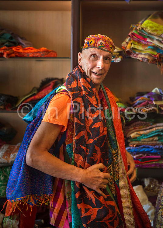 Andrew Logan, LBGQT British artist searching for colourful Indian fabrics on 4th February 2018 in Jaipur, Rajasthan, India. The annual Alternative Miss World is the brainchild of this polymath performance artist, sculptor and jewellery maker Andrew Logan now in his 76th year.