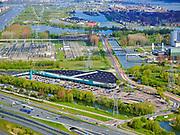Nederland, Noord-Holland, Muiden, 07-05-2021; Maxis Megastores, oudste weidewinkel van Nederland.<br /> Over-Diemen en Vattenfall Elektriciteitscentrale Diemen op het tweede plan. <br /> Maxis Megastores, Over-Diemen and Vattenfall Diemen Power Plant on the second plan.<br /> luchtfoto (toeslag op standaard tarieven);<br /> aerial photo (additional fee required)<br /> copyright © 2021 foto/photo Siebe Swart