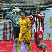 Galatasaray's Engin Baytar (C) and Sivasspor's goalkeeper Milan Borjan (L), Doudou Jacques Faty (R) during their Turkish Superleague soccer match Galatasaray between Sivasspor at the Turk Telekom Arena at Aslantepe in Istanbul Turkey on Saturday 26 November 2011. Photo by TURKPIX