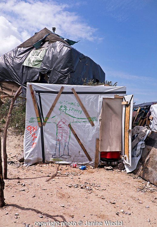 Makeshift accommodation in The Calais Jungle Refugee and Migrant Camp in France