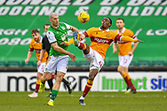 Devante Cole (#44) of Motherwell FC gets to the ball ahead of Alex Gogic (#13) of Hibernian FC during the SPFL Premiership match between Hibernian FC and Motherwell FC at Easter Road, Edinburgh, Scotland on 27 February 2021.
