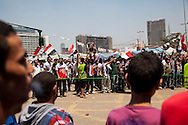 Demonstrators in Tahrir Square this morning, behind a line set up as a women's area.