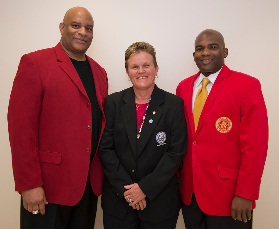 Houston ISD Athletic Director Marmion Dambrino, center, poses for a photograph with Yates High School boy's basketball coach Greg Wise, left, and principal Donetrus Hill, right, August 15, 2014. The Yates Lions were awarded the 2013 and 2014 UIL State Championships following a ruling stripping Dallas Madison of the awards.