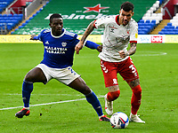 Football - 2020 / 2021 Sky Bet Championship - Cardiff City vs Middlesbrough - Cardiff City Stadium<br /> <br /> <br /> Marvin Johnson of Middlesbrough on the attack, 0Gavin Whyte of Cardiff City defends  in a match played without fans<br /> <br /> COLORSPORT