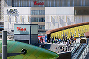 Pedestrians and shoppers are seen on the steps at one of the entrances of Westfield at Stratford, on 11th August 2021, in London, England.