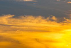 London Heathrow, September 19th 2015. A Boeing 777 departs London heathrow into a fiery sky.