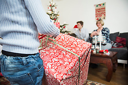 Boy unwrapping Christmas gift