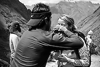 On the way to Dead Woman's Pass a trekker inhales smelling salts to counter the effects of altitude sickness. The Inca trail, Peruvian Andes