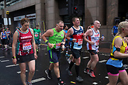 Participants taking part in the London Marathon running some four miles to go to complete the race on 23rd April 2017 in London, England, United Kingdom.
