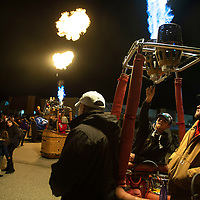 Shane Shipman (far right) stands in a balloon basket as Morghan Chando pulls the burner sending a flame up during the candlestick glow at Rio West Mall, Saturday, Nov. 1, in Gallup as part of the Red Rock Balloon Rally.