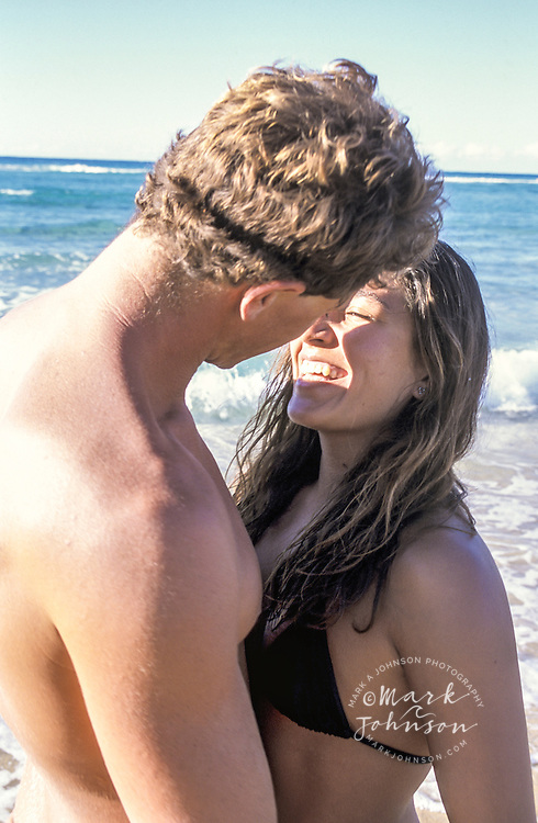 Australia, Queensland, N. Stradbroke Island, happy couple on beach.  MR available people ****Model Release available