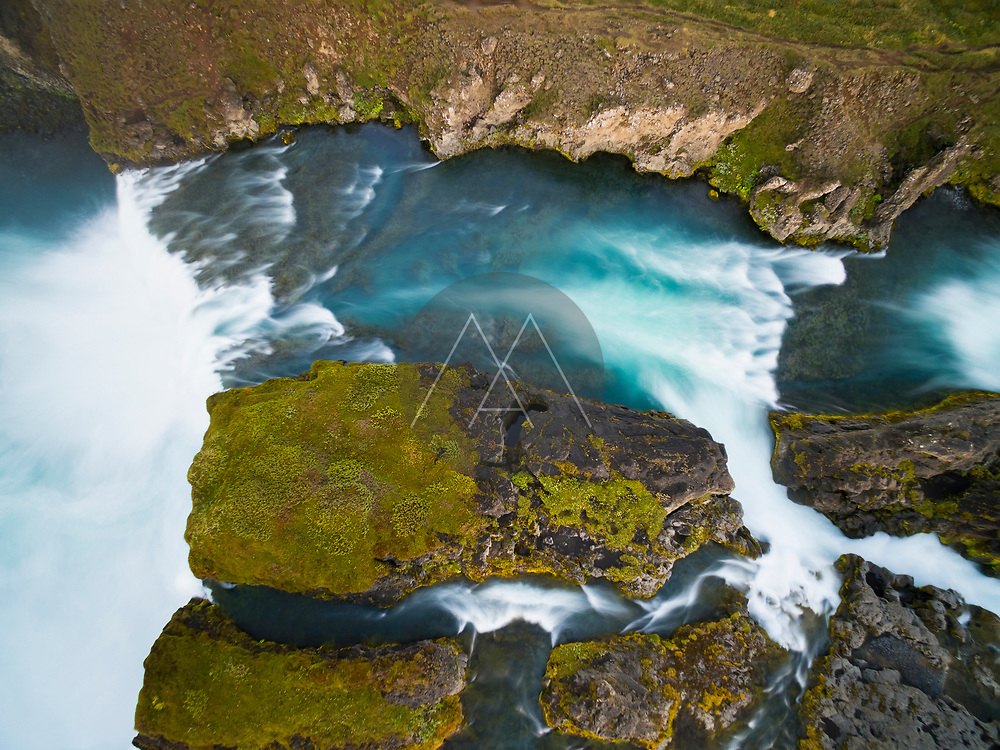 Aerial view of waterfall captured with long exposure, Þingeyjarsveit, Godafoss, Iceland.