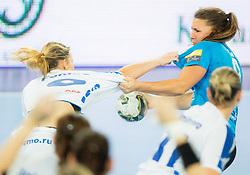 Ekaterina Fanina of Dinamo vs Melanie Bak #9 of Krim Mercator during handball match between RK Krim Mercator (SLO) and Dinamo - Sinara (RUS) in 4th Round of Women's EHF Champions League 2014/15, on November 9, 2014 in Arena Stozice, Ljubljana, Slovenia. Photo by Vid Ponikvar / Sportida