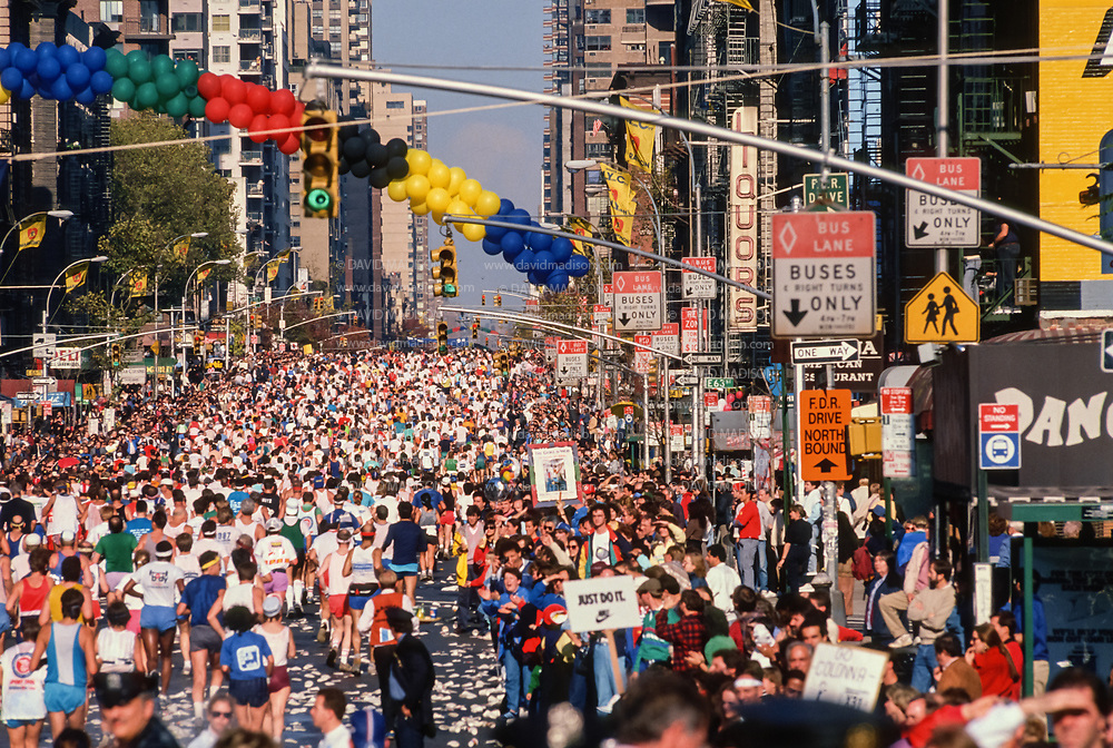 NEW YORK - NOVEMBER 3:  Runners competing in the 1991 New York City Marathon run on First Avenue in Manhattan near the midway point of the race on November 3, 1991 in New York, New York.  (Photo by David Madison/Getty Images)