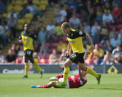 Watford's Almen Abdi is tackled by Nottingham Forest's Matt Derbyshire  - Photo mandatory by-line: Nigel Pitts-Drake/JMP - Tel: Mobile: 07966 386802 25/08/2013 - SPORT - FOOTBALL -Vicarage Road Stadium - Watford -  Watford v Nottingham Forest - Sky Bet Championship