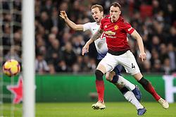 Tottenham Hotspur's Harry Kane (left) attempts a shot on goal