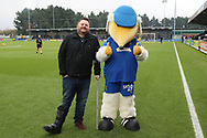 AFC Wimbledon fan with broken ankle posing with Haydon the Womble during the EFL Sky Bet League 1 match between AFC Wimbledon and Southend United at the Cherry Red Records Stadium, Kingston, England on 24 November 2018.