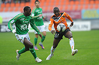 FOOTBALL - FRENCH CHAMPIONSHIP 2009/2010 - L1 - FC LORIENT v AS SAINT ETIENNE - 28/03/2010 - PHOTO PASCAL ALLEE / DPPI - SIGAMARY DIARRA (FCL) / MOUHAMADOU DABO (ASSE)