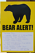 A sign alerting visitors to the presence of bears on Bird Creek in Kongiganak, outside Anchorage, Alaska.