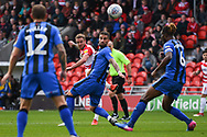 James Coppinger of Doncaster Rovers (26) takes a shot at Max Ehmer of Gillingham (5) does his best to put him off with an attempted block during the EFL Sky Bet League 1 match between Doncaster Rovers and Gillingham at the Keepmoat Stadium, Doncaster, England on 20 October 2018.