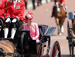 The Duchess of Cambridge waves as the Royal procession makes its way up The Mall from Horse Guards Parade, central London to Buckingham Palace following the Trooping the Colour ceremony as the Queen celebrates her official birthday today.