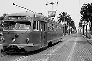 A black and white picture in San Francisco showing a streetcar going to the Castro District.