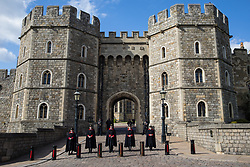 Wardens stand guard outside the King Henry VIII gateway to Windsor Castle on the eve of the funeral of the Duke of Edinburgh on 16th April 2021 in Windsor, United Kingdom. The funeral of Prince Philip, Queen Elizabeth II's husband, will take place at St George's Chapel in Windsor Castle at 15:00 BST on 17th April, with the ceremony restricted to 30 mourners in accordance with current coronavirus restrictions.