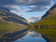 The Boundary Mountains including Long Knife Peak, Mount Custer and Parke Peak reflected in Kintla Lake, Glacier National Park, Montana