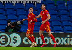 CARDIFF, WALES - Wednesday, November 18, 2020: Wales' Harry Wilson (L) celebrates after scoring the first goal with team-mate Rhys Norrington-Davies during the UEFA Nations League Group Stage League B Group 4 match between Wales and Finland at the Cardiff City Stadium. Wales won 3-1 and finished top of Group 4, winning promotion to League A. (Pic by David Rawcliffe/Propaganda)