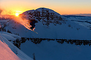 Jake Hawkes sending it into the sunset, skiing somewhere in the tetons,  Wydaho, WY