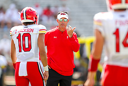 Sep 4, 2021; College Park, Maryland, USA; Maryland Terrapins offensive coordinator Dan Enos talks to his quarterbacks prior to their game against the West Virginia Mountaineers at Capital One Field at Maryland Stadium. Mandatory Credit: Ben Queen-USA TODAY Sports