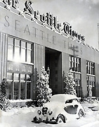 This forlorn automobile stalled in front of The Seattle Times office. More than a foot of snow covered Fairview Avenue North and John Street. It also drifted through an open window into the car's interior. The Times published its editions as usual despite the weather. (The Seattle Times, 1950)