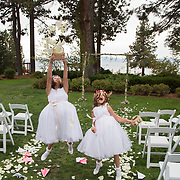 Flower girls jump for joy and release flowers into the air in celebration.