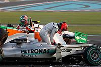 MOTORSPORT - F1 2010 - ABU DHABI GRAND PRIX - YAS MARINA (UAE) - 11 TO 14/11/2010 - PHOTO : FREDERIC LE FLOC H / DPPI - <br /> MICHAEL SCHUMACHER (GER) - MERCEDES MGP GP W01 - ACTION  <br /> VITANTONIO LIUZZI (ITA) - FORCE INDIA VJM03 - ACTION