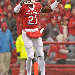 Dec 5, 2009; Piscataway, NJ, USA; Rutgers cornerback Devin Mccourty (21) encourages the crowd during first half NCAA Big East college football action between Rutgers and West Virginia at Rutgers Stadium.