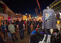 Roadhouse vendors are busy with traffic on Friday evening of Bike Week.  (Karen Bobotas/for the Laconia Daily Sun)