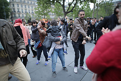 © Licensed to London News Pictures . 07/05/2017 . Paris , France . Music and dancing at Place de la Republique as Le Pen concedes defeat to Macron . The electorate are voting in the final round of the French election . Emmanuel Macron's En Marche and Marine Le Pen's Front National are competing for the Presidency . Photo credit: Joel Goodman/LNP