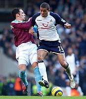 Photo: Daniel Hambury.<br />Tottenham Hotspur v West Ham Utd. The Barclays Premiership. 20/11/2005.<br />West Ham's Matthew Etherington battles with Spurs' Jermaine Jenas.
