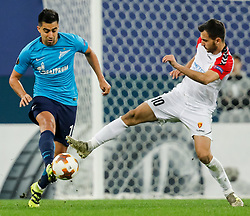 November 23, 2017 - Saint Petersburg, Russia - Christian Noboa (L) of FC Zenit Saint Petersburg and Boban Nikolov of FK Vardar vie for the ball during the UEFA Europa League Group L match between FC Zenit St. Petersburg and FK Vardar at Saint Petersburg Stadium on November 23, 2017 in Saint Petersburg, Russia. (Credit Image: © Mike Kireev/NurPhoto via ZUMA Press)