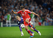02.10.2013 Manchester, England.  Bayern Munich's Thomas Muller makes it 2-0 during the Group D UEFA Champions League game between, Manchester City and Bayern Munich from the Etihad Stadium.