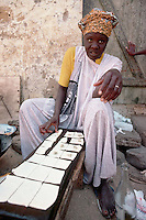 February 1978, Ile de la Goree, Dakar, Senegal --- Woman Preparing Food to be Cooked --- Image by © Owen Franken