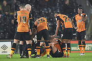 Hull City defender Michael Dawson injured after header  during the Sky Bet Championship match between Hull City and Bolton Wanderers at the KC Stadium, Kingston upon Hull, England on 12 December 2015. Photo by Ian Lyall.
