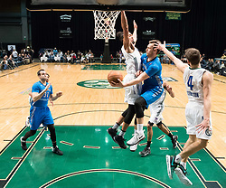 March 20, 2017 - Reno, Nevada, U.S - Texas Legends Guard KYLE COLLINSWORTH (6) dishes the ball to teammate Texas Legends Guard JJ AVILA (31) with Reno Bighorn Forward WILL DAVIS II (0) defending during the NBA D-League Basketball game between the Reno Bighorns and the Texas Legends at the Reno Events Center in Reno, Nevada. (Credit Image: © Jeff Mulvihill via ZUMA Wire)