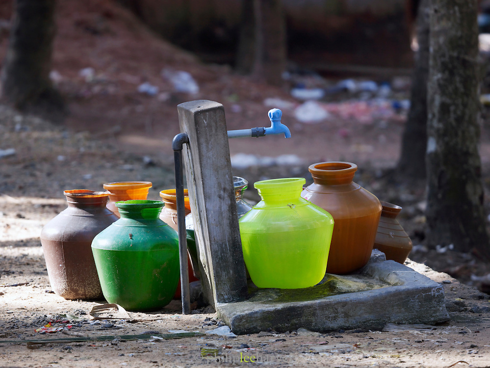Containers at a water tap, Odayam Beach, Kerala, India